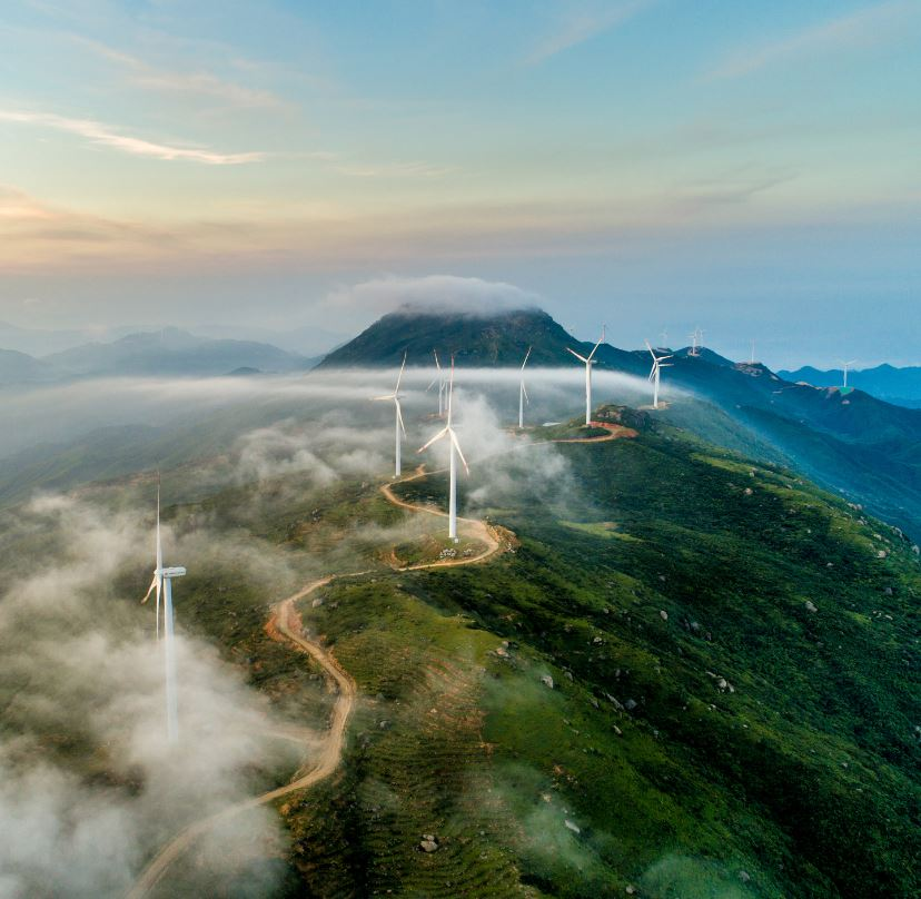 Wind Turbines On Cloudy Hillside