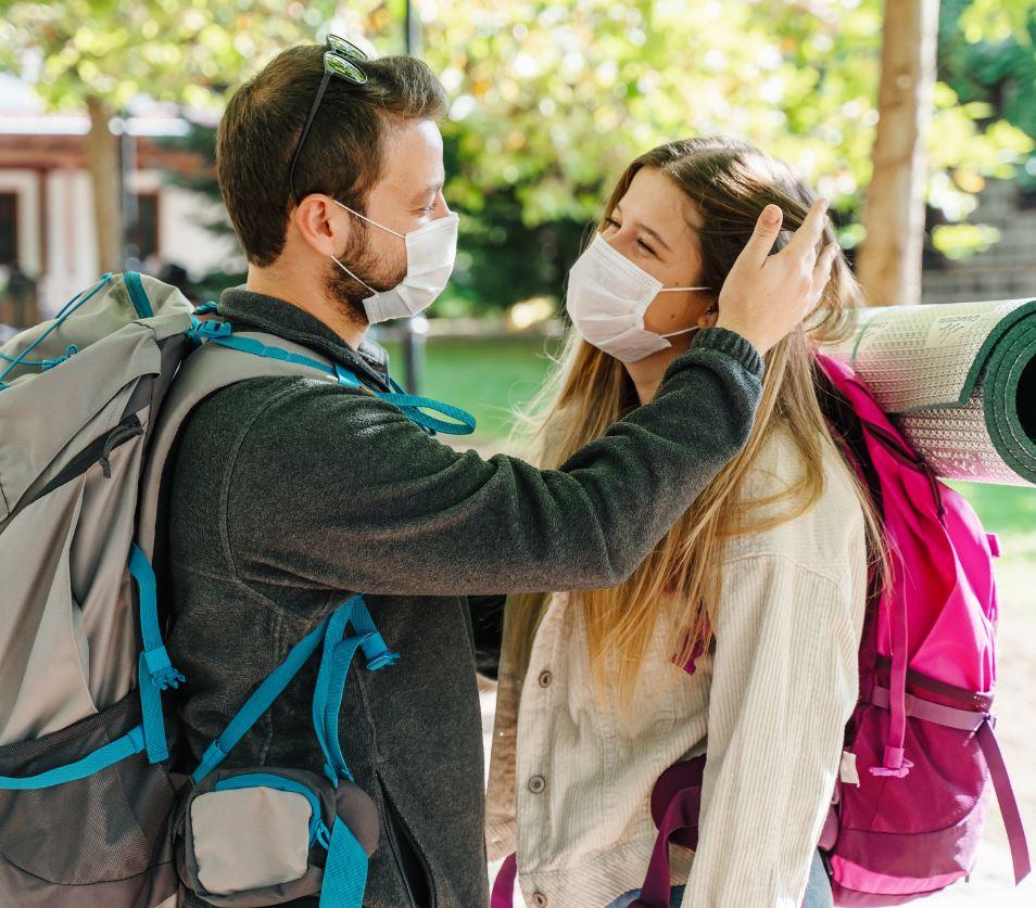couple backpack masks travel