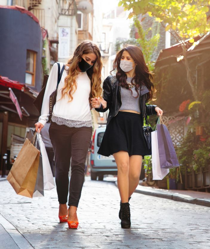 females shopping traveling in masks