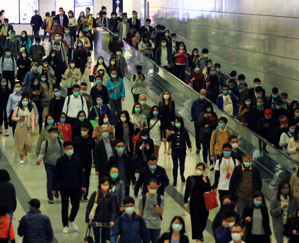hong kong busy street wearing masks
