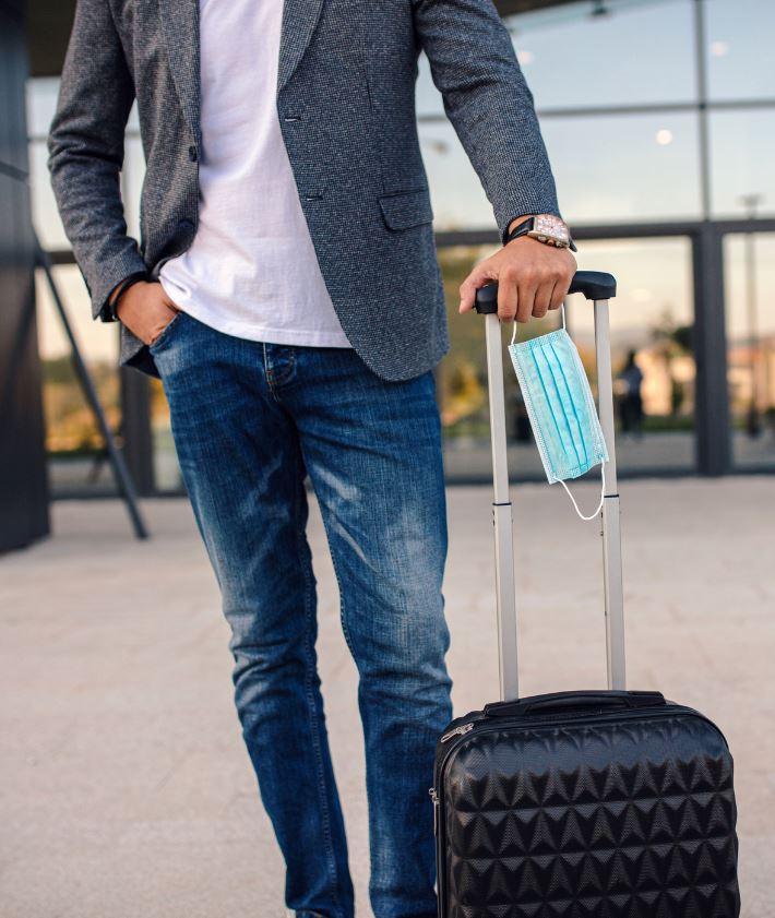 male traveler mask luggage