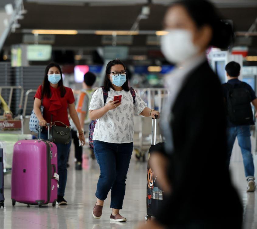 masked passengers at airport