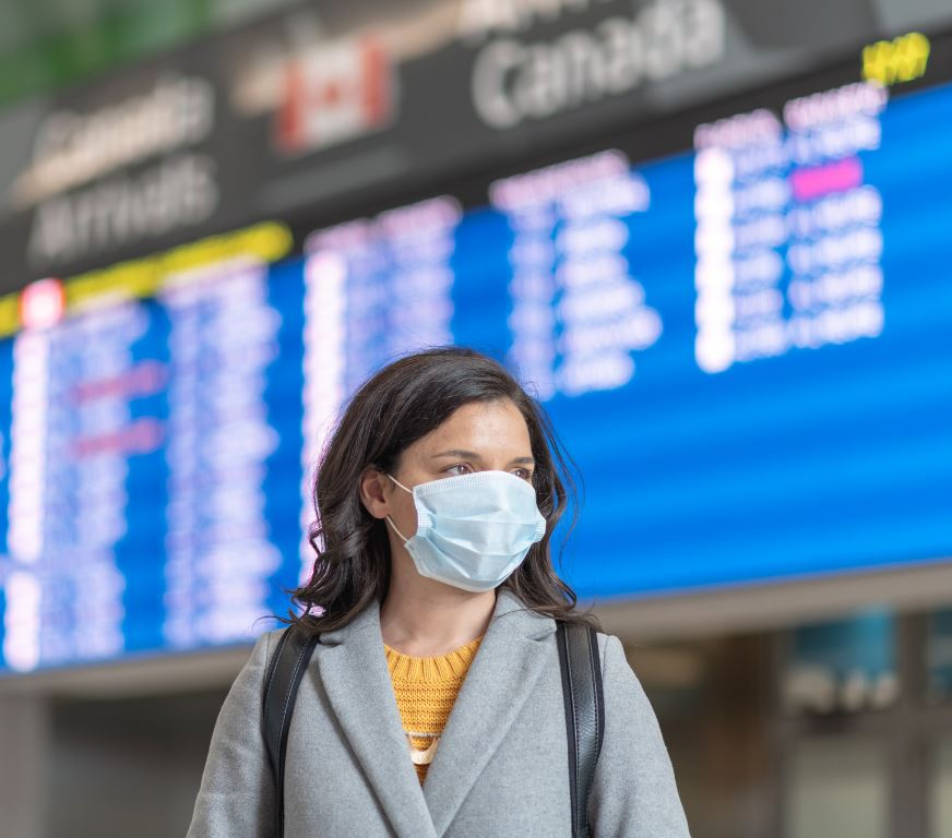 masked woman at canadian airport