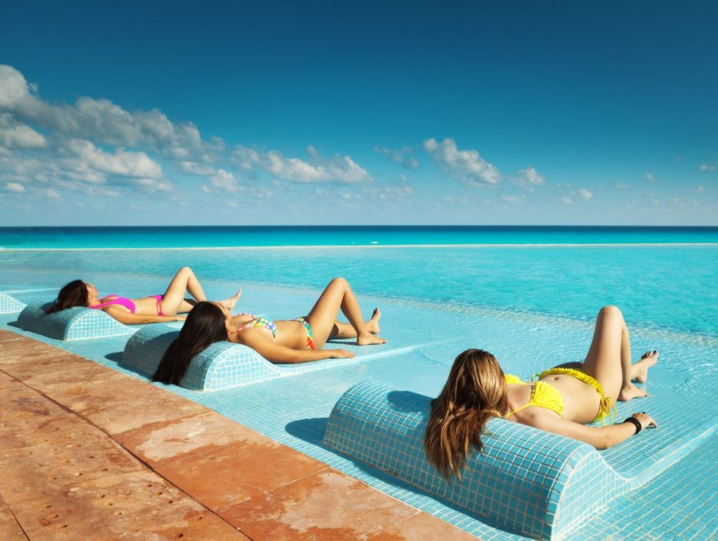 tourists tanning in cancun