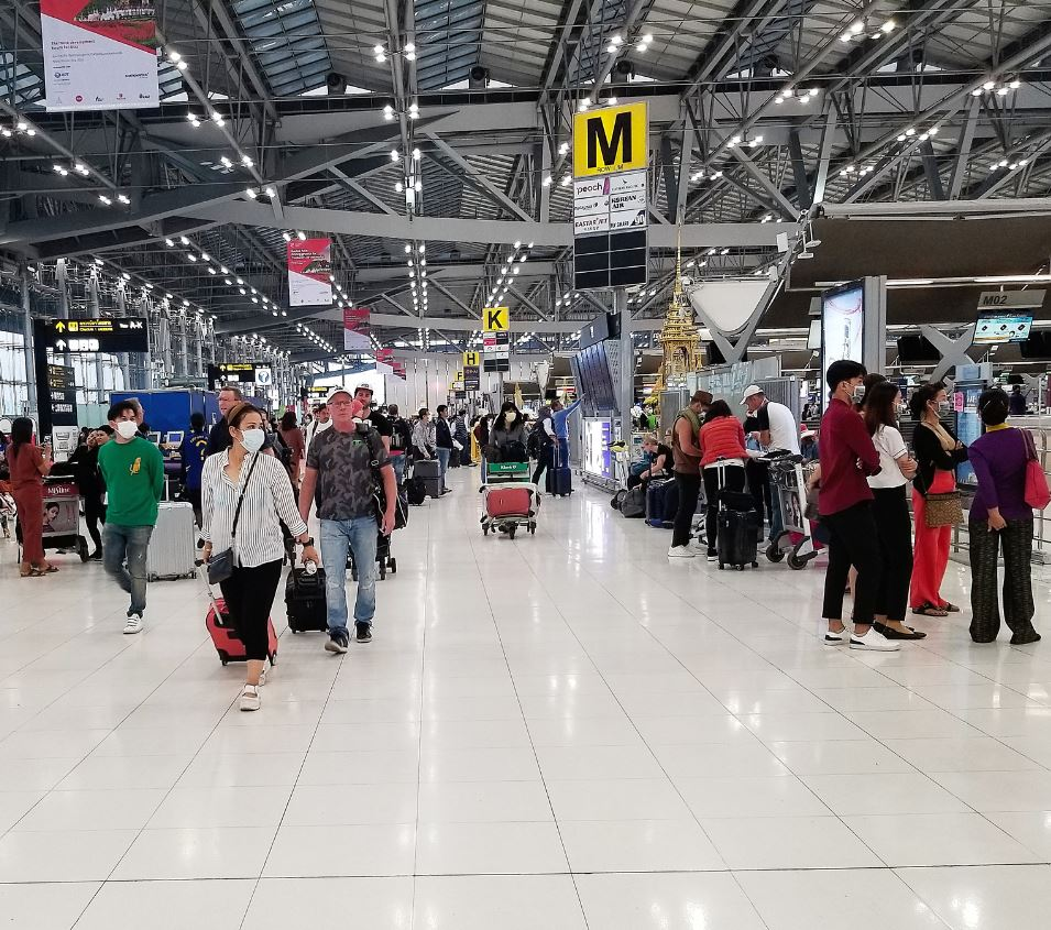 travelers arrive at bangkok airport