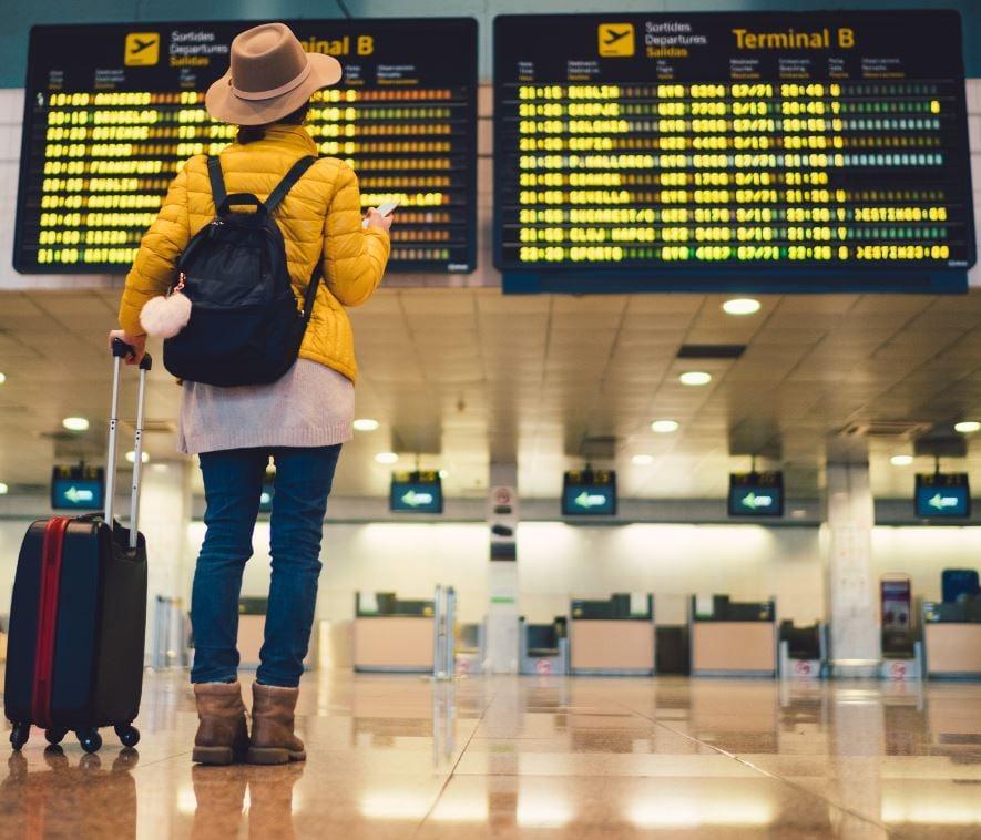 woman looking at departure board