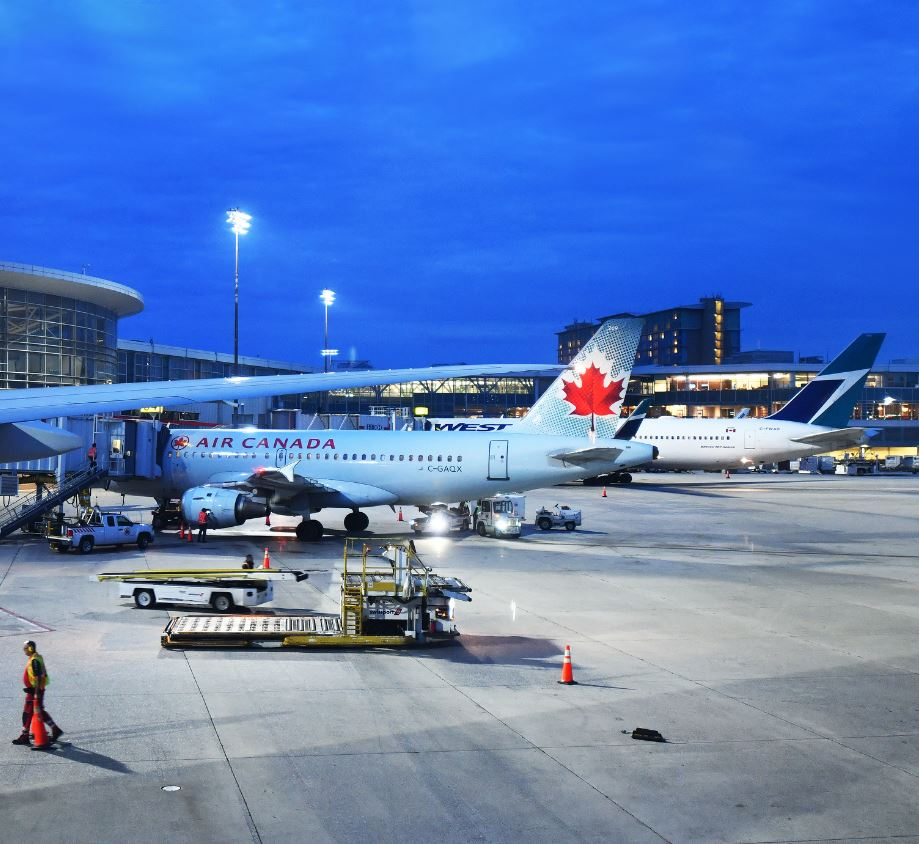 Air canada and west jet plane parked on tarmac