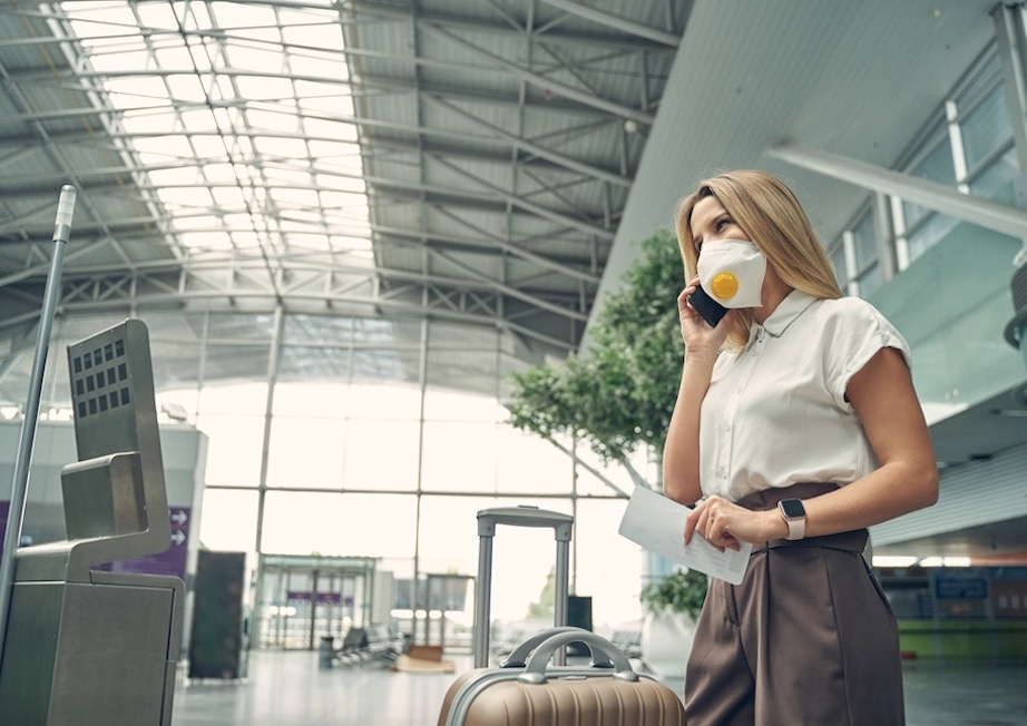 American traveler in mask at airport