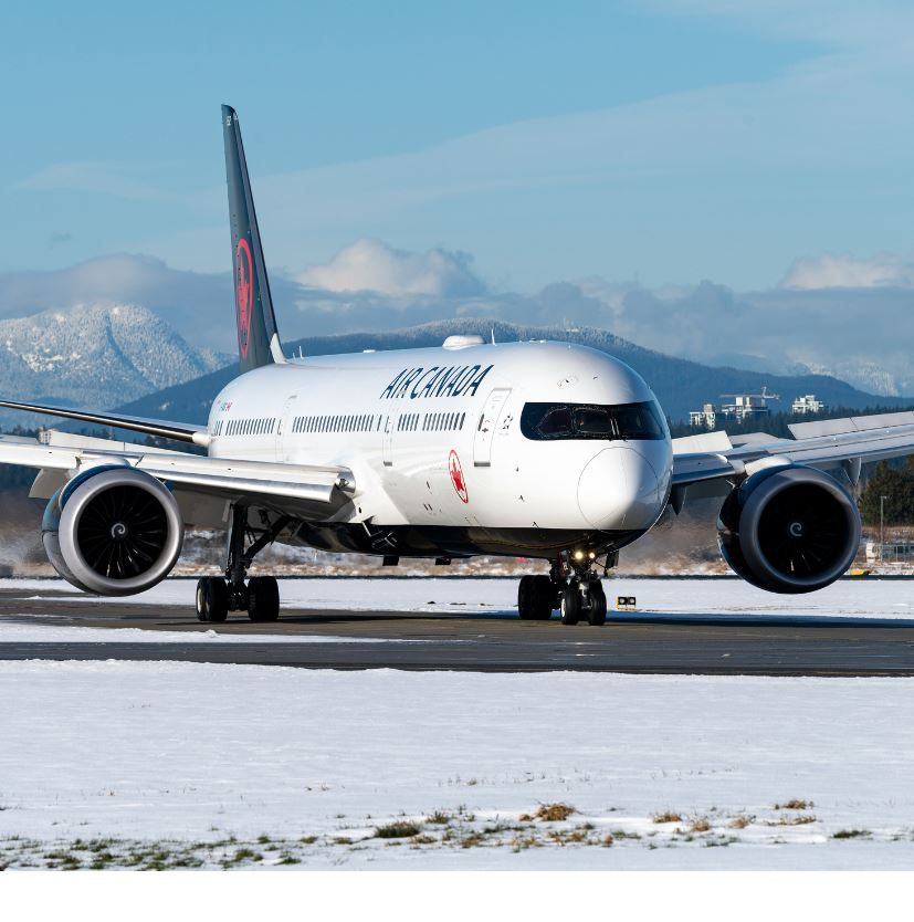 air canada plane on runway in winter