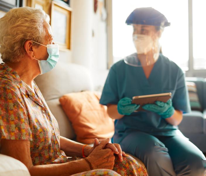 covid mask nurse vulnerable old lady