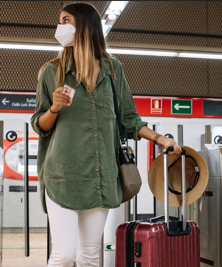 female traveler luggage mask at airport