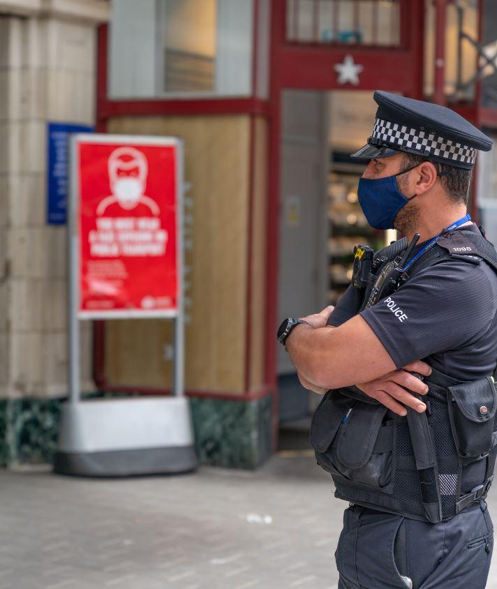 uk officer in mask