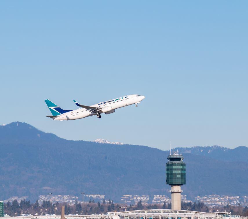 westjet flight taking off at vancouver airport