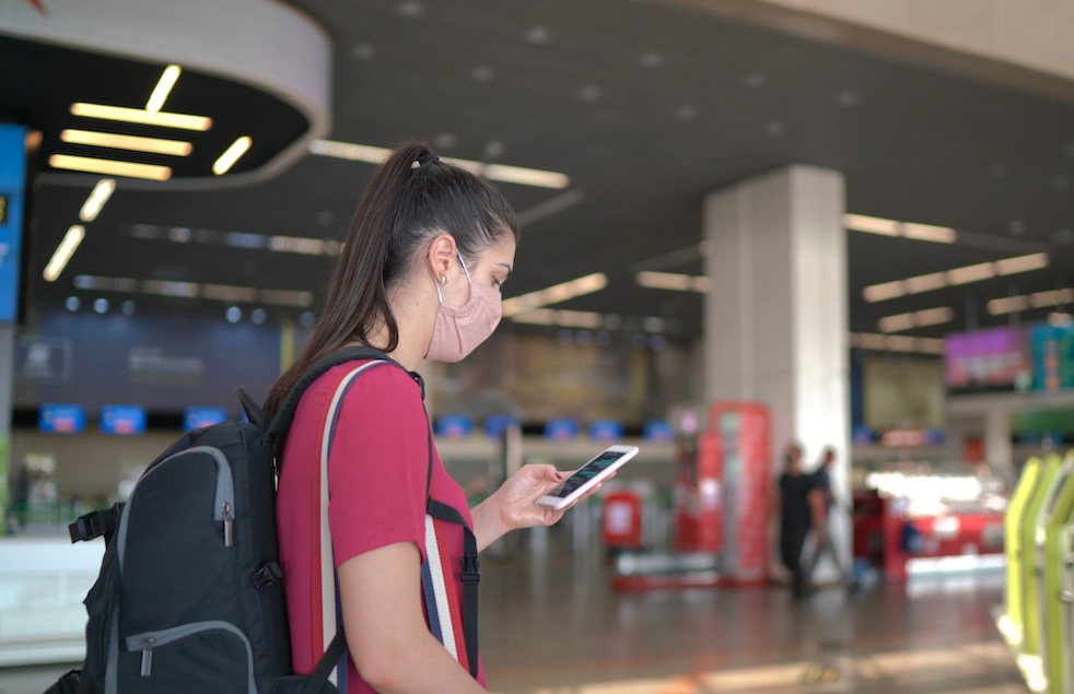 woman traveler in mask at airport