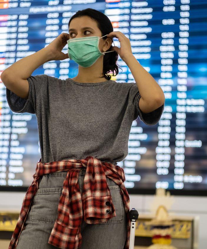 woman wearing mask traveling