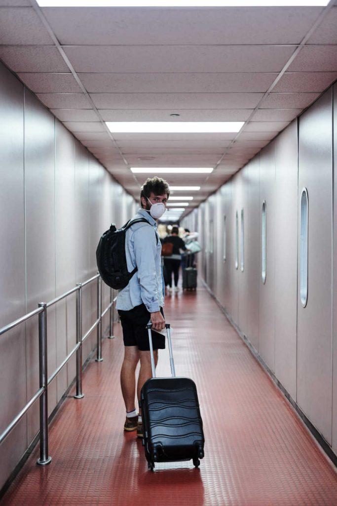 Man boarding flight in mask