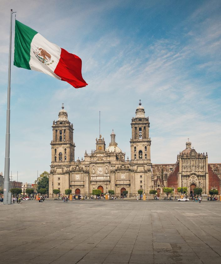 Mexico city cathedral and mexico flag