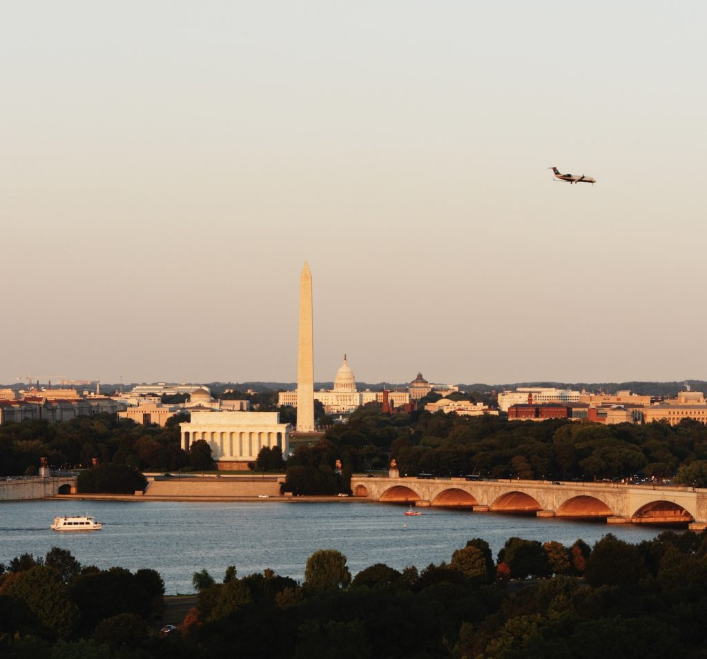 Plane hovering over Washington Capitol Building