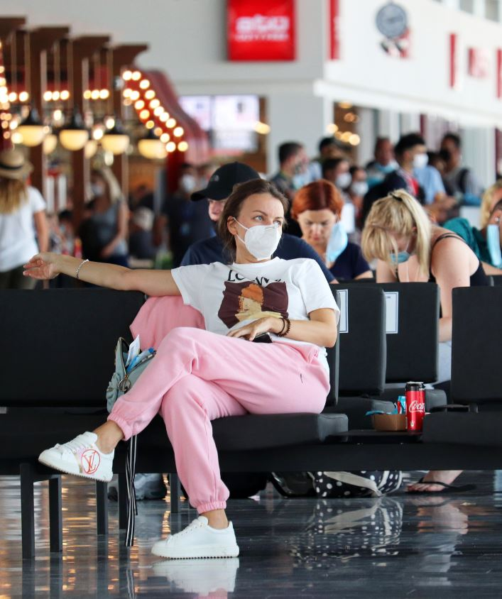 UK traveler at airport wearing mask