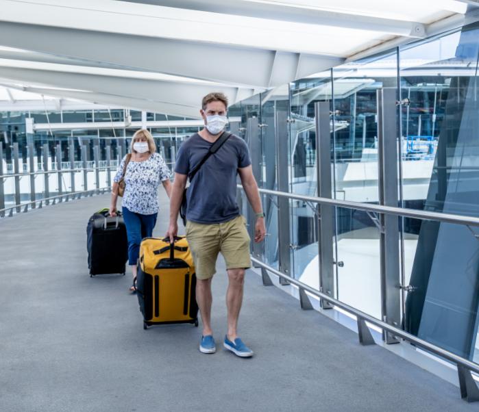 australian travelers masks suitcases