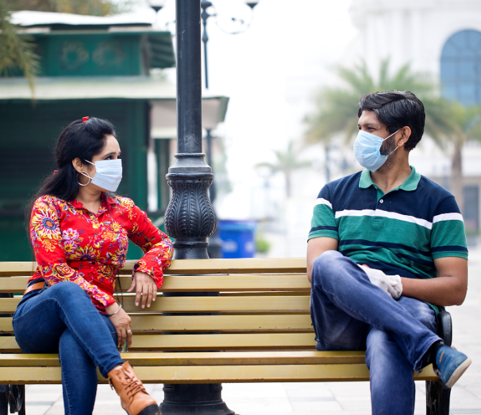india couple social distancing masks