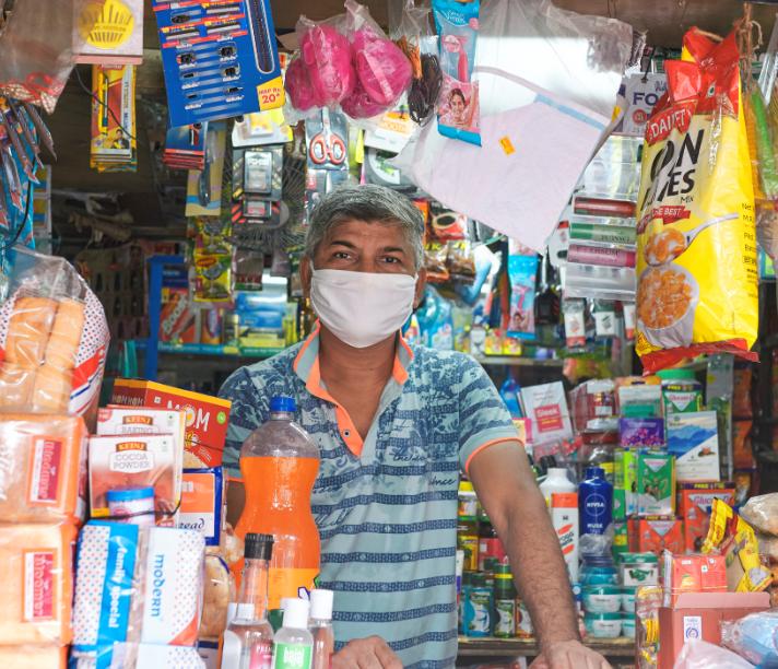 indian market shop owner mask