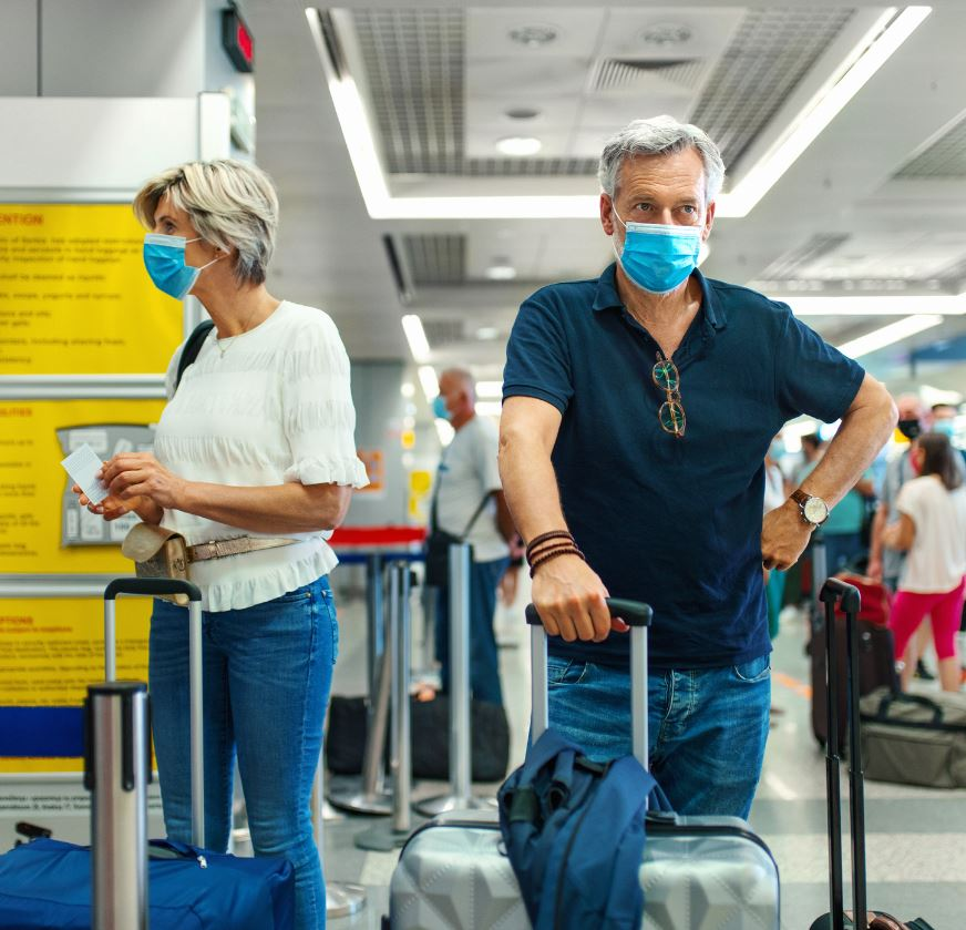 older couple at airport wearing masks