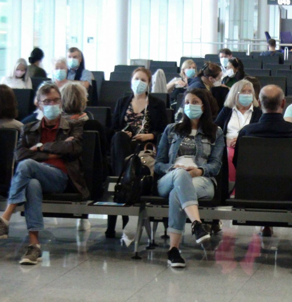 passengers airport waiting to board pandemic