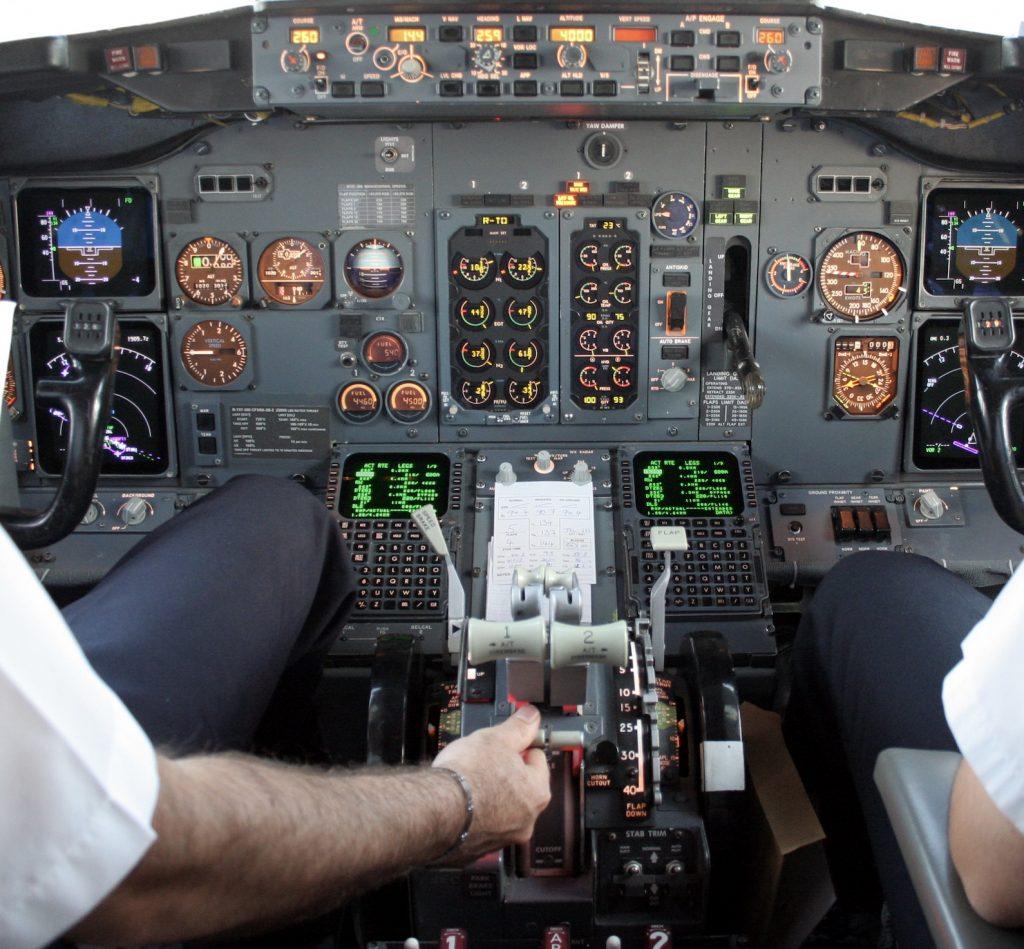 pilot cockpit airplane takeoff