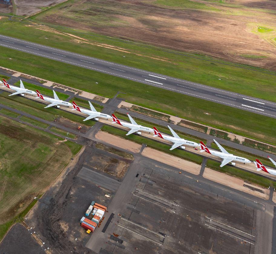 qantas planes parked on runway