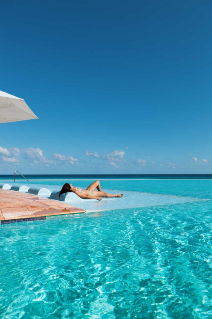resort pool traveler tanning in mexico