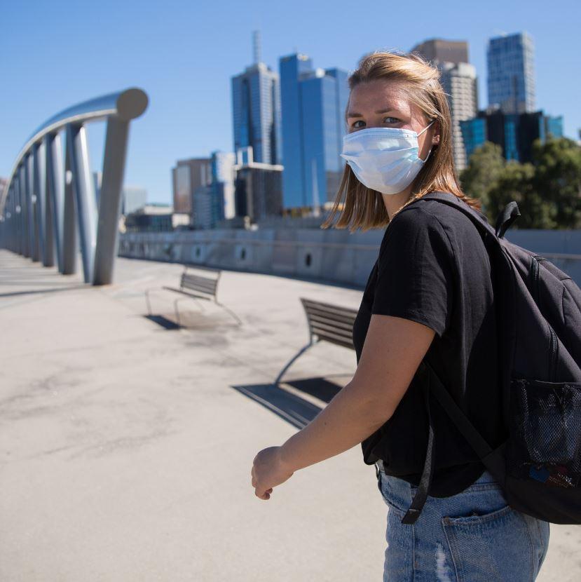 traveler in melbourne wearing mask