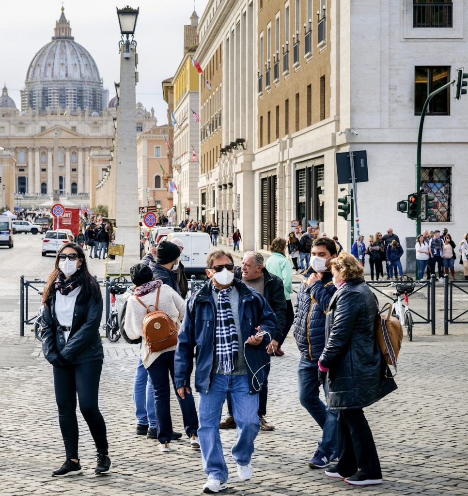 travelers in Italy masks