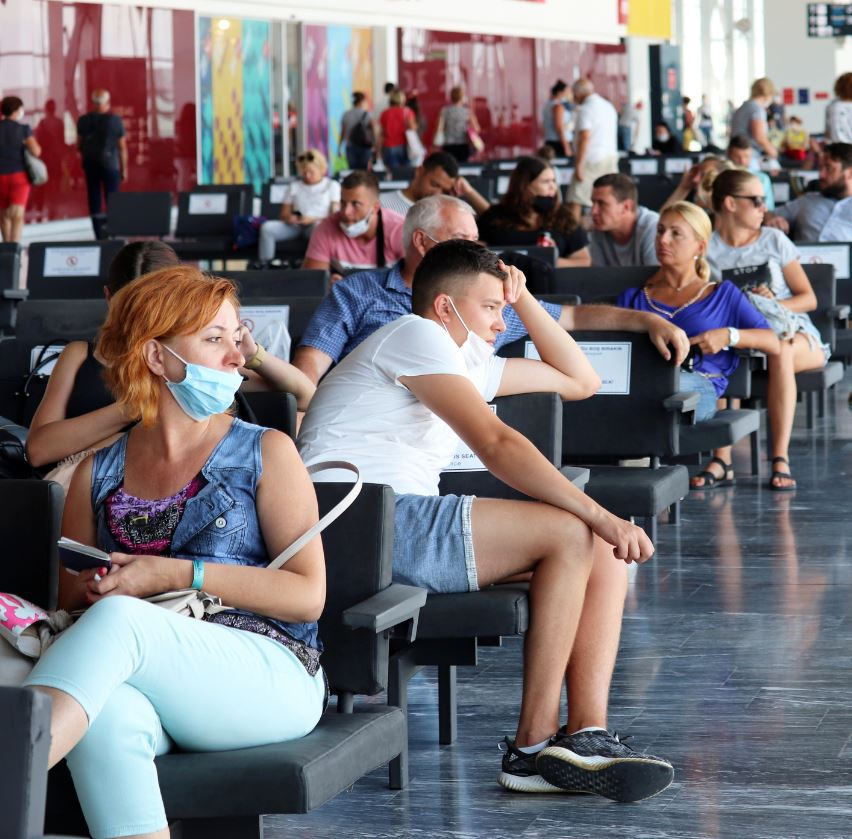 travelers waiting for flight during covid