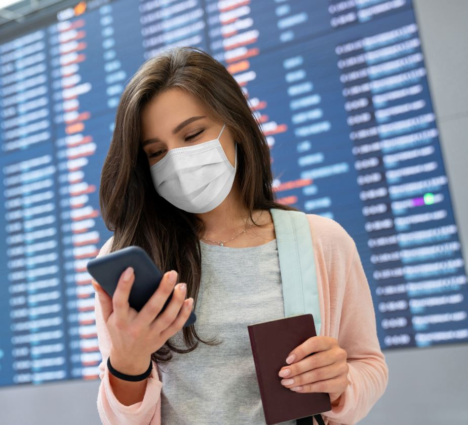 woman checking flight status in mask (1)