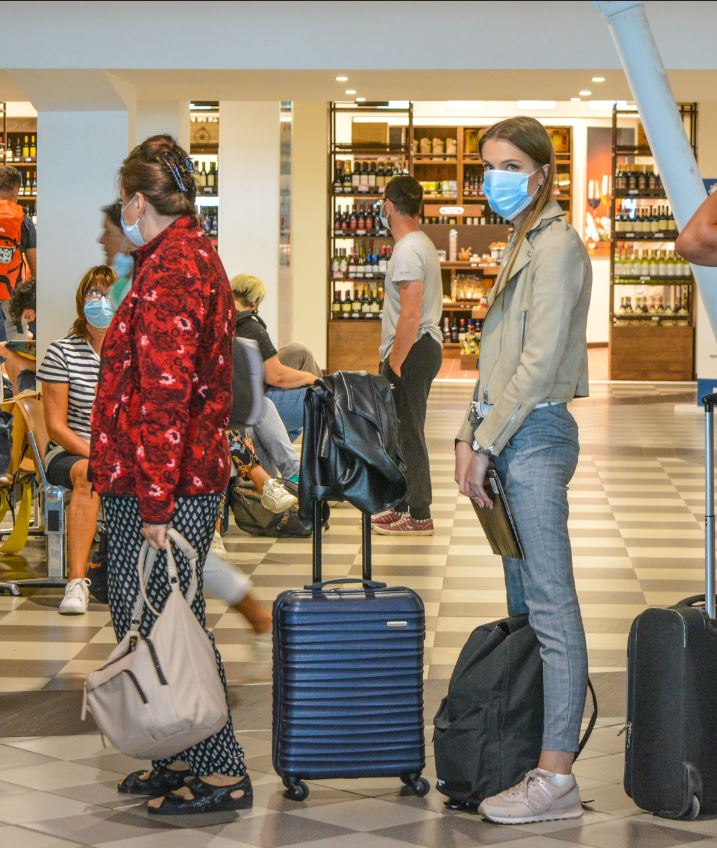 woman checking flight status in mask (2)