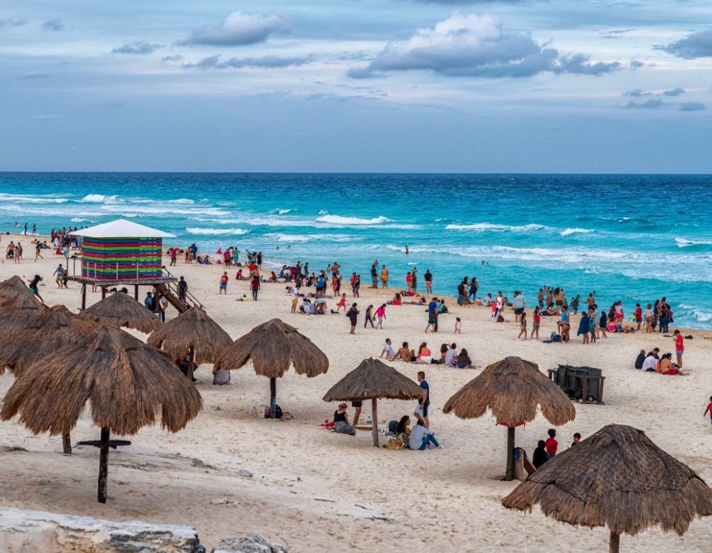 Cancun beach tourists