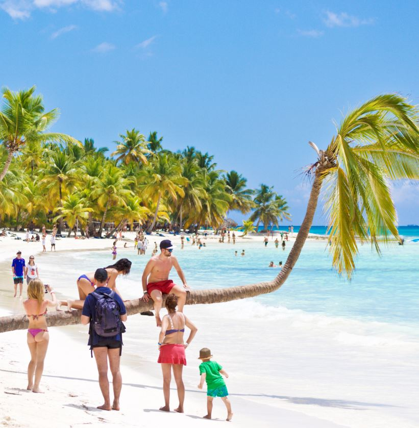 Dominican Republic Tourists walking on beach