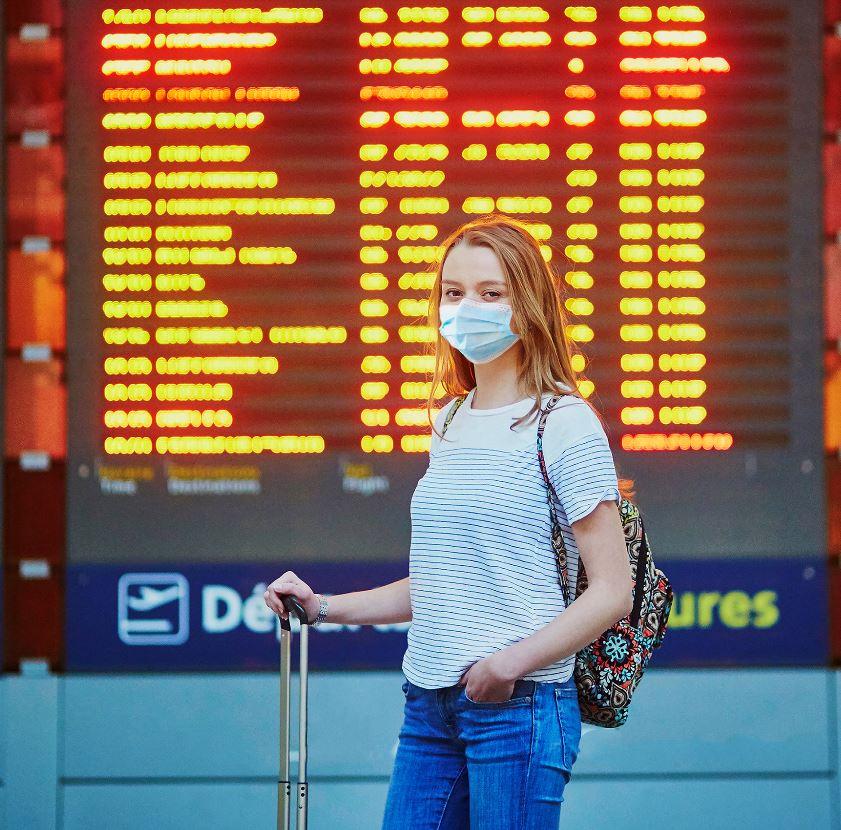 Female Traveler at airport wearing mask