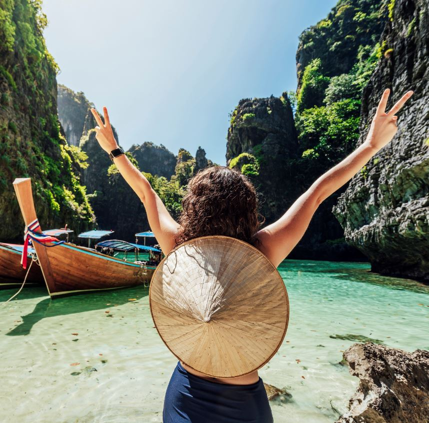 Tourist in Thailand excited about ocean and cliffs