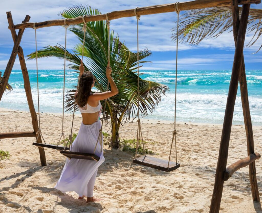 Tulum Female Tourist on Swing at Beach