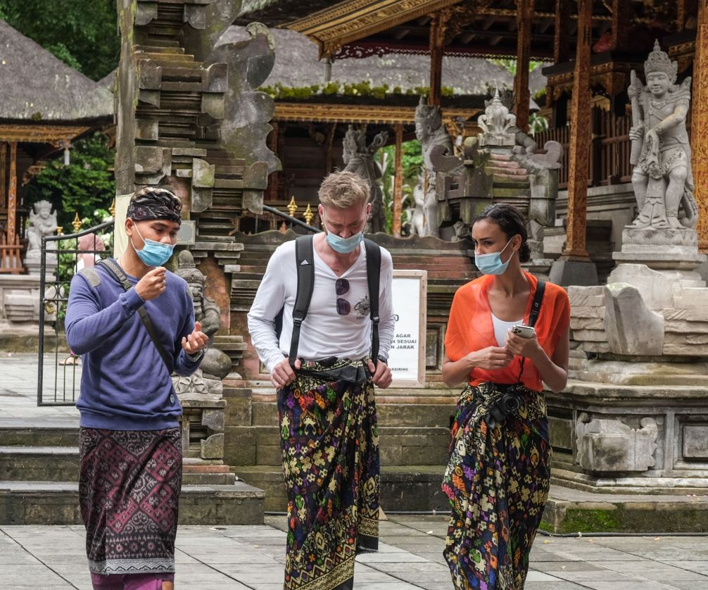 bali tourists wearing masks at temple