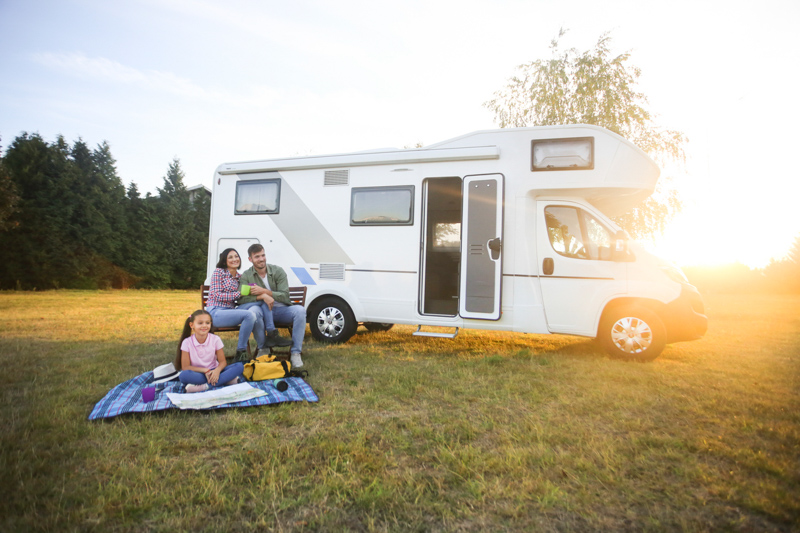 Family camping in a campervan outside