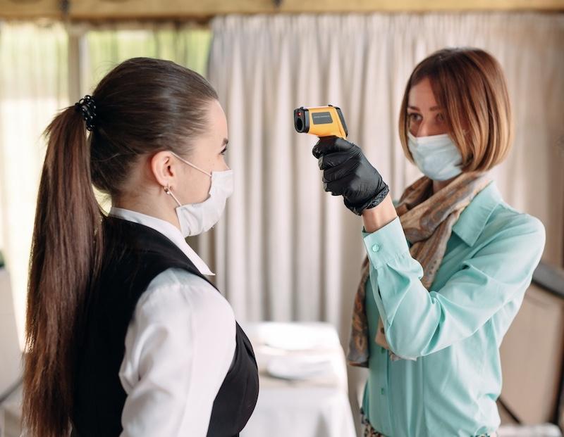 hotel staff mask temperature check