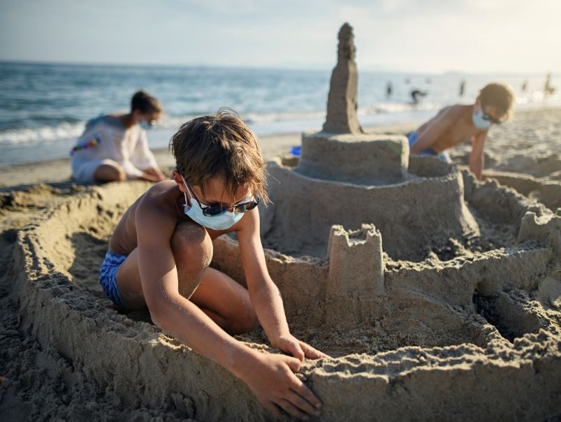 kid beach sandcastle