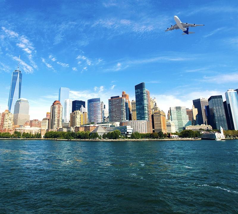 plane above New York skyline