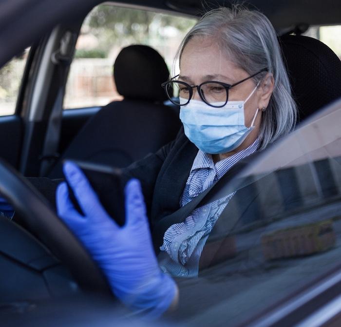 senior woman mask in car