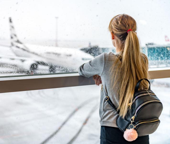 traveler airport snow
