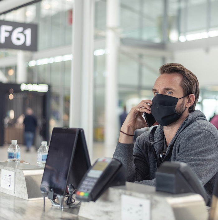 traveler at airport face mask