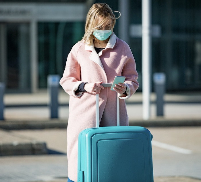 traveler mask airport suitcase